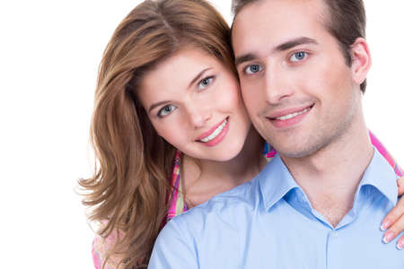 playfulness: Closeup portrait of beautiful smiling couple isolated on white background. Attractive man and woman being playful. Stock Photo