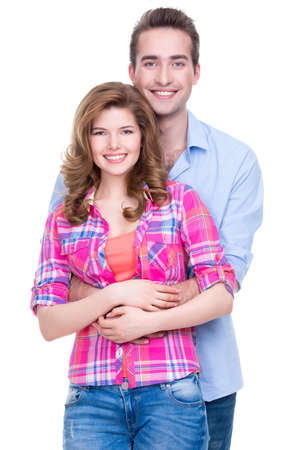 boyfriend: Portrait of young happy attractive couple standing in studio isolated on white background.