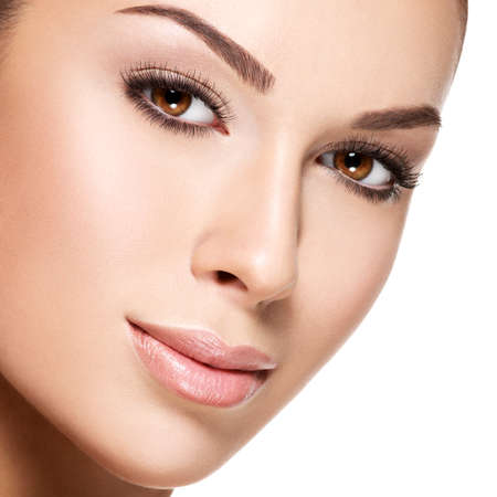 beautiful face woman: Beautiful face of young caucasian woman with perfect health fresh skin  - isolated on white.  Skin care concept.