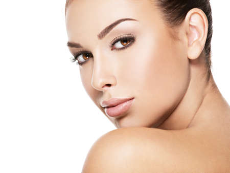 woman eye: Beautiful face of young caucasian woman with perfect health fresh skin  - isolated on white.  Skin care concept.