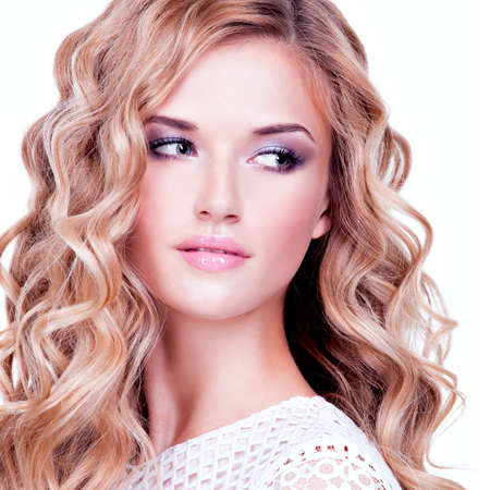 looking to side: Closeup portrait of pretty blonde girl with wavy  hairs looking side - isolated on white.