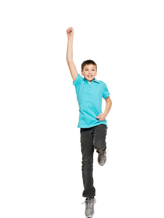 10 year old: Portrait of  laughing happy teen boy jumping with raised hands up - isolated on white background