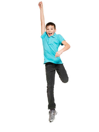 cheerful: Portrait of  laughing happy teen boy jumping with raised hands up - isolated on white background