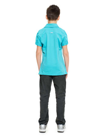 Full portrait of teen boy standing back in casuals - isolated on white background 스톡 콘텐츠