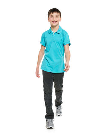 casuals: Full portrait of smiling  walking teen boy in blue t-shirt casuals  isolated on white background.