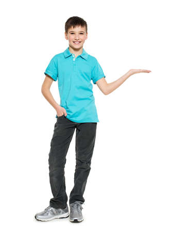 child boy: Young smiling teen boy shows  something on palm  isolated on white background.