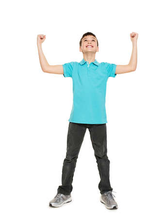 blue shirt: Portrait of  laughing happy teen boy  with raised hands up - isolated on white background