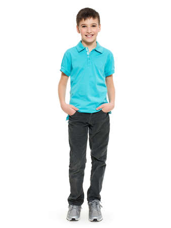 Young pretty boy posing at studio as a fashion model. Photo of preschooler 8 years old over white background Standard-Bild
