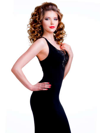 Portrait of beautiful woman in black dress with curly hair - isolated on a white background.
