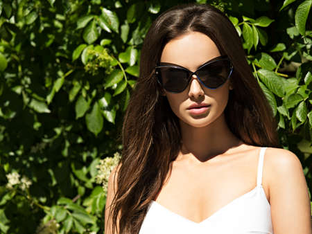 black hairs: young beautiful woman with long hairs in black sunglasses.