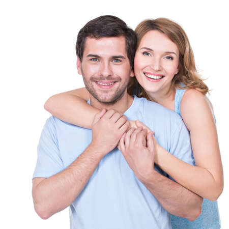 playfulness: Portrait of happy embracing couple in casual -  isolated on white background. Stock Photo