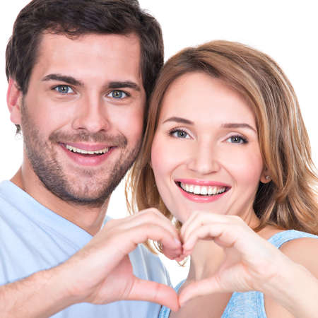 show of hands: Closeup portrait of of cheerful smiling couple standing together show hands heart -  isolated on white background. Stock Photo