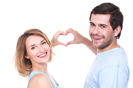 white heart: Portrait of cheerful smiling couple standing together show hands heart -  isolated on white background.