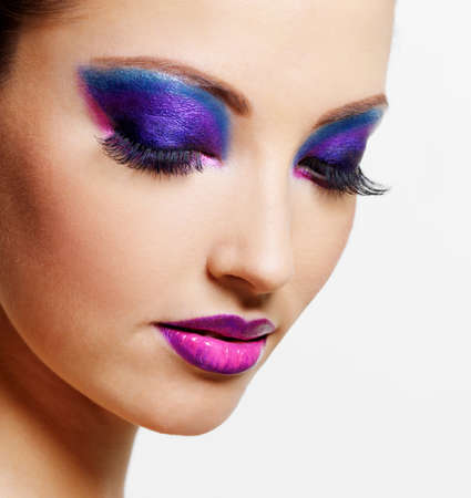Beautiful sexy female face with bright beauty fashion make-up photo