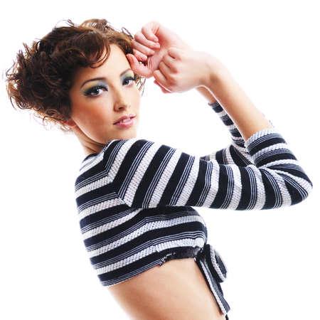 Fashion image of beautiful young woman posing photo