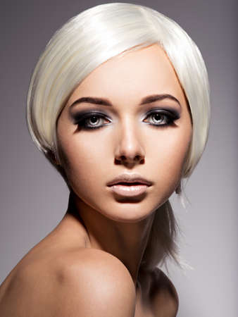 nude blonde girl: Fashion portrait of young woman with blond hairs and black makeup of eye