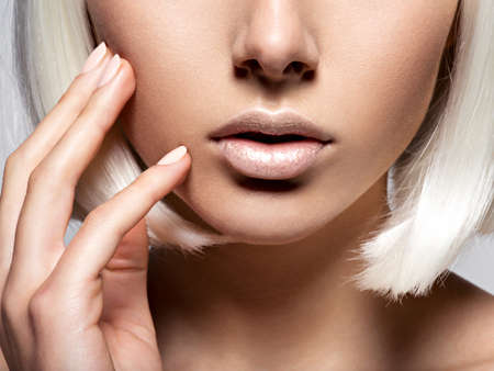 unrecognizable person: Womens lips  closeup. unrecognizable person. half face Stock Photo