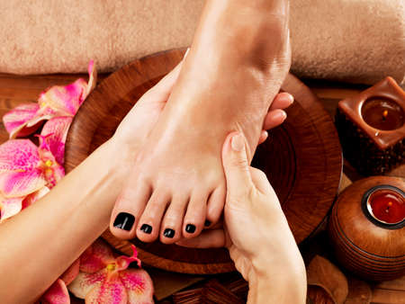 beautiful feet: Massage of womans foot in spa salon - Beauty treatment concept