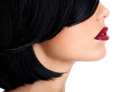 black hairs: Beautiful woman with  sexy red lips and shot black hairs - studio