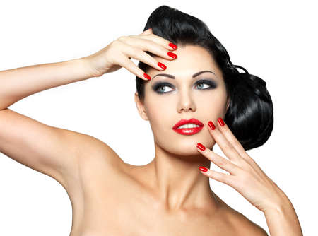 red nail colour: Beautiful young woman with red nails and fashion makeup - isolated on white background Stock Photo