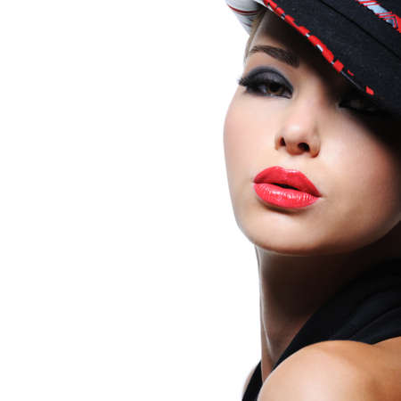 Portrait of sensuality stylish woman in the fashion hat with bright red lips photo