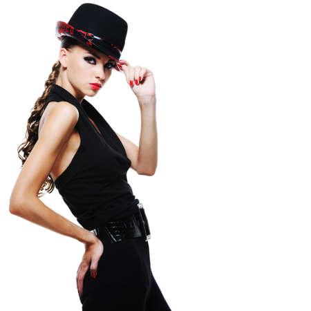 Luxury glamour elegant adult girl in black dress with stylish black hat photo