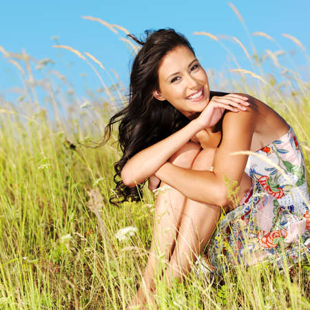 Portrait of the young beautiful smiling woman outdoors photo