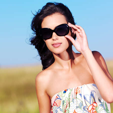 beautiful sexy woman on the nature in black sunglasses Stock Photo - 53558595