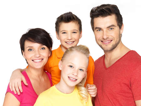 Photo of the happy young family with two children isolated on white background photo