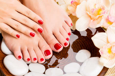 foot spa: Closeup photo of a beautiful female feet at spa salon on pedicure procedure