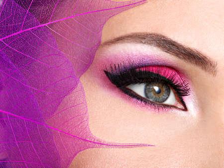 make: Closeup female eye with  beautiful fashion bright pink makeup