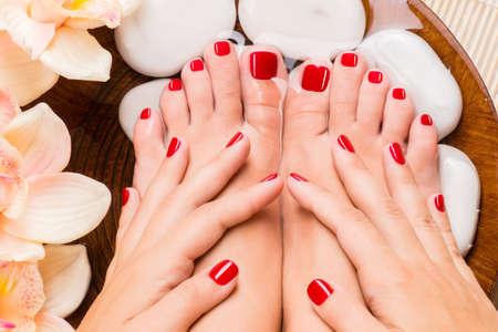 spa pedicure: Closeup photo of a beautiful female feet at spa salon on pedicure procedure