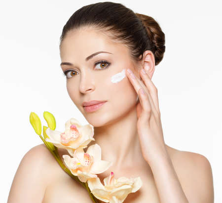 fresh cream: Young woman with cosmetic  cream on a clean fresh face. Healthy lifestyle concept Stock Photo