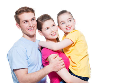 aucasian: Portrait of the happy young family with child in multicolor shirts - isolated on white background.