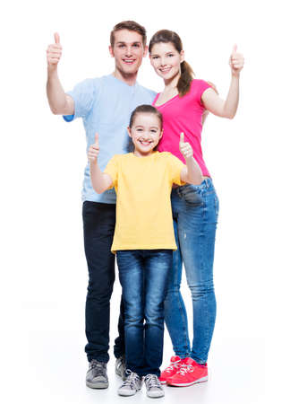 aucasian: Portrait of the happy european family with child shows the thumbs up sign - isolated on white background.