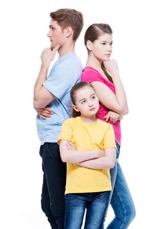 aucasian: Thoughtful family with daughter standing back to back at studio -  isolated on white. Stock Photo