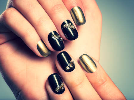 nails: Beautiful womans nails with beautiful creative manicure Stock Photo
