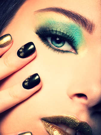 eye makeup: Close-up woman face with green eye make-up. Stock Photo