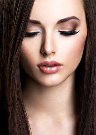 elegancy: Face of beautiful young woman with brown make-up and  straight  hair Stock Photo