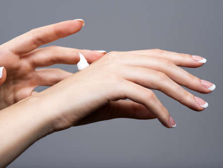 Beautiful woman hands with hand cream.