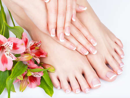 foot spa: Closeup photo of a female feet at spa salon on pedicure and manicure procedure - Soft focus image