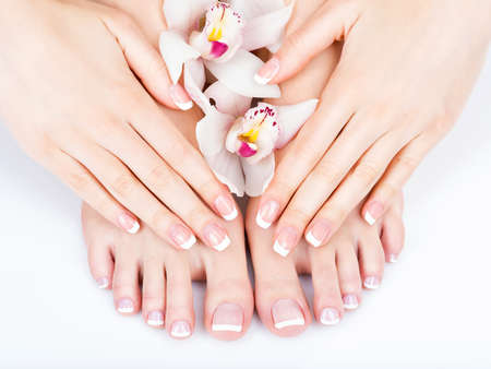 Closeup photo of a female feet at spa salon on pedicure and manicure procedure - Soft focus image Reklamní fotografie - 54100907