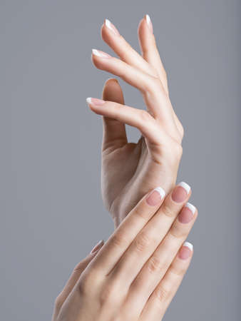 nails: Beautiful female hands with french manicure on nails