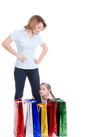 distraught: Distraught girl sitting by his mother after shopping Stock Photo