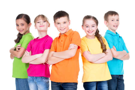 Group of smiling children with crossed arms in colorful t-shirts standing together on white background.