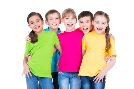 Group of happy children in colorful t-shirts standing together on white background.