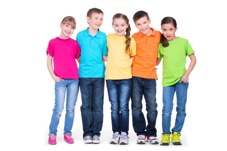 coloured: Group of happy children in colorful t-shirts standing together in full length on white background.