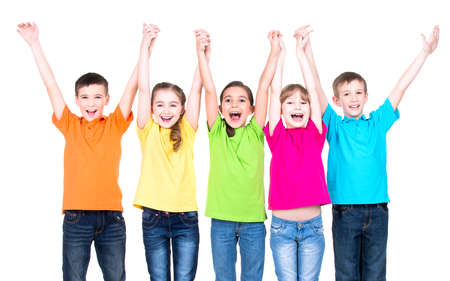 Group of smiling children with raised hands in colorful t-shirts standing together - isolated on white.
