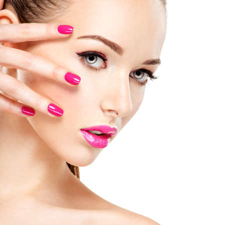 nails woman: Beautiful woman face with pink makeup of eyes and nails. Glamour fashion model portrait