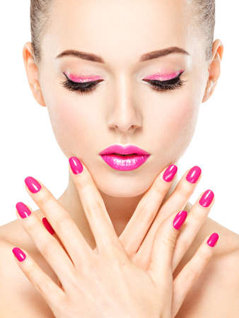 Beautiful woman face with pink makeup of eyes and nails. Glamour fashion model portrait Stock Photo